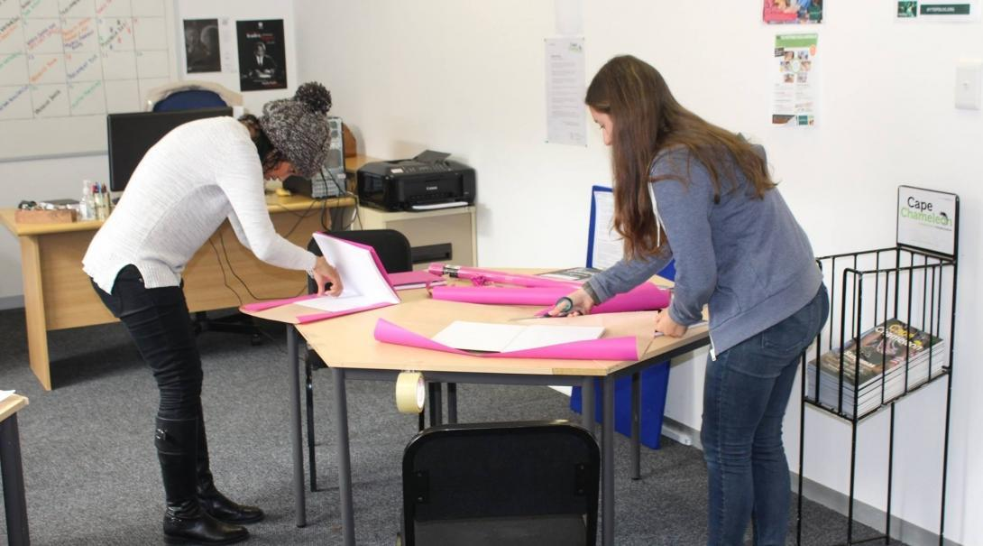 Students doing Journalism internships in South Africa create materials for a creative workshop.